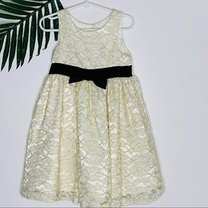 Ivory and gold lace dress with black velvet bow